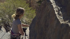 Agile Rock Climber Master Her Route Up Cliff Face (Slow Motion) Stock Footage