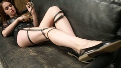 Young sexy brunette girl in leather garters Stock Footage