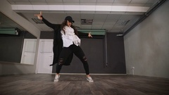 Young girl dancing modern dance in black clothes. Dancer makes a quick and Stock Footage
