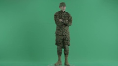 Serviceman standing and rounding at green screen Stock Footage