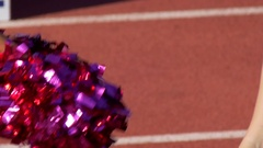 Cheerleaders at a football game, slow motion. Stock Footage