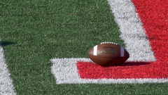 Detail of an American football, slow motion. Stock Footage
