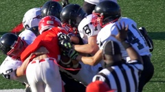 Men playing American football, slow motion. Stock Footage