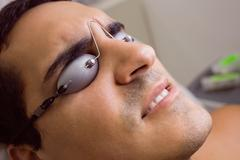 Patient wearing laser protective glasses Stock Photos