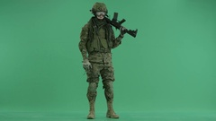 Soldier stretching hand at green screen Stock Footage
