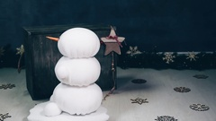 Handmade snowman with crocheted shawl, hat rotating. Stock Footage