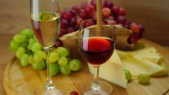 Plate with Grapes, Cheese and Glasses of Wine. Stock Footage
