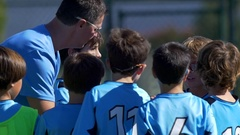 A soccer football coach talks to his team, slow motion. Stock Footage
