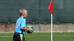 A boy does a throw-in of the ball while playing youth soccer football, slow moti Stock Footage