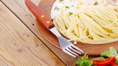 Wild salmon baked in cream cheese sauce with italian pasta Stock Footage