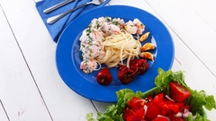 Salmon baked in cream cheese sauce with italian pasta and vegetable Stock Footage