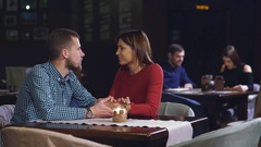 Young couple sitting in the restaurant Stock Footage