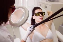 Female patient receiving laser hair removal treatment Stock Photos