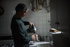 Man poring hot water from flask Stock Photos