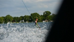 A man wakeboarding behind a boat. Stock Footage