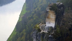 Rock formation cliff, lush green forest, Saxon Switzerland, Bastei, Elbe river Stock Footage