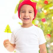 Christmas portrait of a child dressed as an elf with candy in the form of a Chri Stock Photos