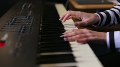 Girl's hands on the keyboard of the piano.  Recording Studio. Stock Footage
