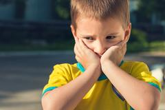 Portrait of the little boy close-up outdoors. He is upset Stock Photos