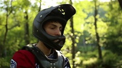 Detail of a man putting his goggles on while wearing a mountain bike helmet, slo Stock Footage