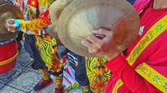 Closeup Schoolboys in Red Play Cymbals in Street Vietnam Stock Footage