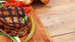 Thick hot beef meat hamburger lunch on wood Stock Footage