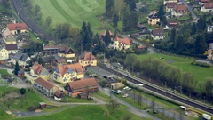 Aerial view train tracks running through small German town, Saxon, Germany Stock Footage