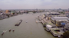 Aerial view of Bangkok, flying over the Chao Praya river Stock Footage