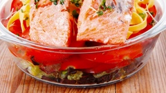 Pink salmon on italian traditional tagliatelles backed with tomatoes Stock Footage
