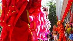 Closeup Boys Dance in Fancy Lion Dress by Street Traffic Stock Footage