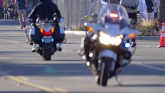 A policeman on his motorcycle at an event. Stock Footage
