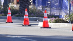 Orange traffic cones in the street at a 10K running race. Stock Footage