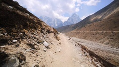 On Dingboche-Lobuche trek in Nepal. Panoramic view of mountains under blue sky Stock Footage