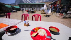 Dal Bhat, garlic soup on the table in Dughla village. Tobuche, Cholatse mounts Stock Footage