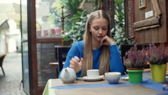 Girl answers cellphone while mixing tea and receives bad news Stock Footage