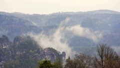 Cloudy fog mist in lush green forest mountains of Bastei, Saxon, Germany Stock Footage