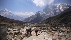 A few trekkers with at rapid ascend on Khumbu glacier. Nepal, Himalaya Stock Footage