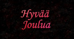 "Merry Christmas text in Finnish ""Hyvaa joulua"" turns to dust from bottom on Stock Footage"