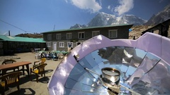 Dughla village with huge projectors and trekkers having a rest. Himalayas, Nepal Stock Footage