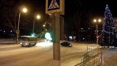 Traffic intersection with traffic lights in a winter city Stock Footage