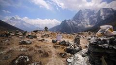 Thokla Pass, Khumbu glacier peak with Climber's Memorials Tombstones. Himalaya Stock Footage