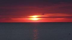 Fiery sunrise at Italian beach. Summer season. Stock Footage
