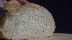 Male hand cutting loaf of bread. Stock Footage