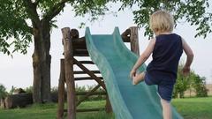 Boy Climb Slide Slip - 4k - Slow motion Stock Footage