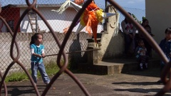 A young girl swings a stick at a pinata. Stock Footage