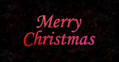 Merry Christmas text turns to dust from bottom on black animated background Stock Footage