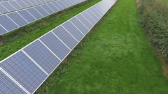 4K Aerial drone footage of large installation of solar panels in the countryside Stock Footage
