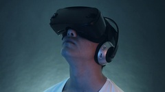 Young Man Wearing VR Headset And Experiencing Virtual Reality Stock Footage