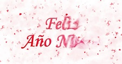 "Happy New Year text in Spanish ""Feliz ano nuevo"" turns to dust from bottom on Stock Footage"