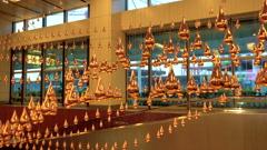 Changi airport, Singapore - 3 November 2016: Kinetic rain installation at Stock Footage